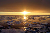 Sun sets over the Arctic (Credit: AFP: NASA) Click to Enlarge.