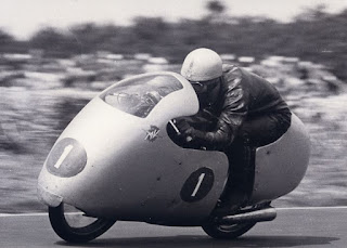 Ubbiali, racing a bike equipped with subsequently outlawed 'dustbin' fairing, in action at his peak in the 1950s