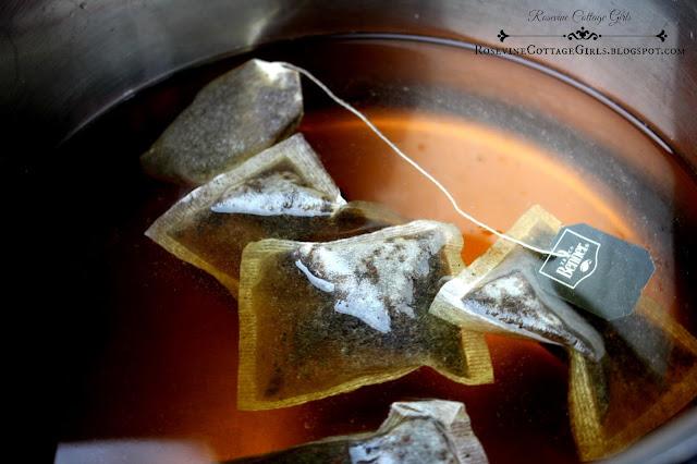 kombucha, kombucha tea, how to make kombucha rosevine cottage girls | rosevinecottagegirls.com | photo of a pan with tea and tea bags in it