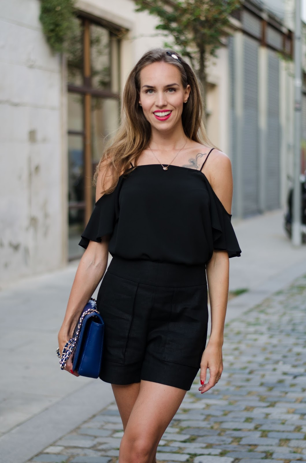 kristjaana mere black off shouder top shorts summer outfit