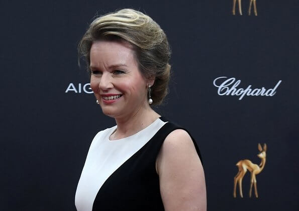 Queen Mathilde wore a two-tone crepe gown by Carolina Herrera. Bambi Awards at Festspielhaus in Baden-Baden