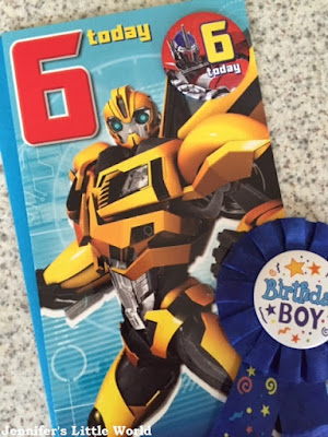 Sixth birthday card and badge