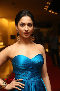 Actress Tamannaah Pictures in Blue Long Dress at Abhinetri Audio Launch  0013