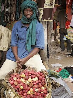 Selling Kola-nut in the market