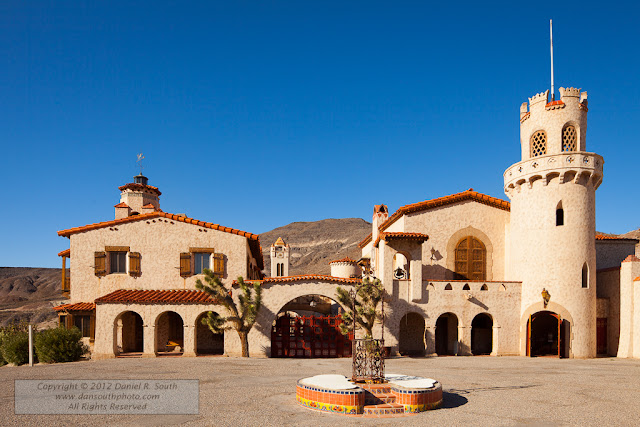a photograph of the facade of scotty's castle in death valley national park