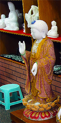 white jade Buddha with ruby dust