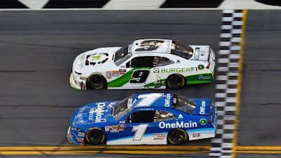 Tyler Reddick (9) beats teammate Elliott Sadler (1) the   NASCAR Xfinity Series race at Daytona International Speedway.