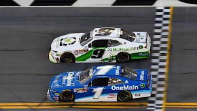 Tyler Reddick (9) beats teammate Elliott Sadler (1) the   NASCAR Xfinity Series race at Daytona International Speedway.
