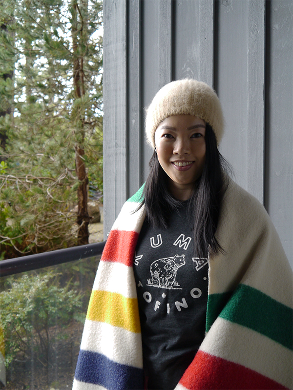 Vancouver beauty, life and style blogger Solo Lisa wraps herself in a Hudson's Bay blanket and wears a Kuma Tofino t-shirt and a camel beanie