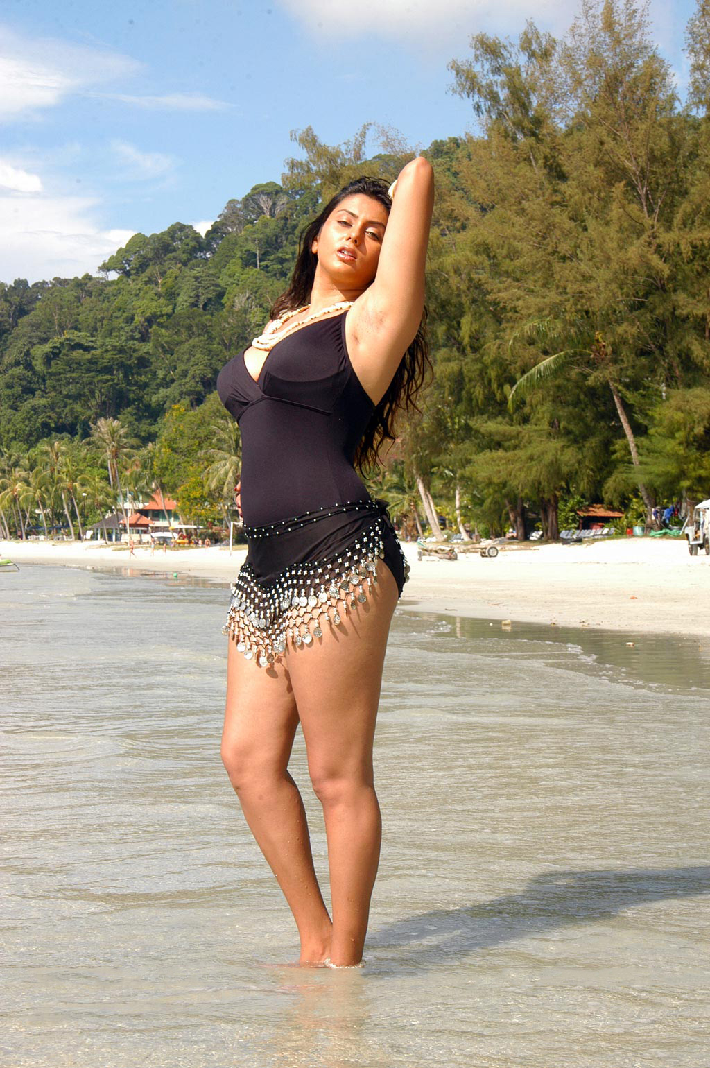 Namitha Kapoor Hot Body Show In Black Swimsuit On The Beach