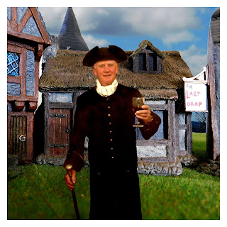 A gentleman in 18th Century Costume with a model village in the background
