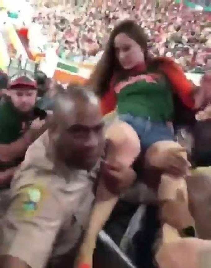 Video shows cop punching a woman who hit him during ejection from UM football game