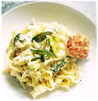 tagliatelle and courgettes in a creamy sauce with fried courgette flower