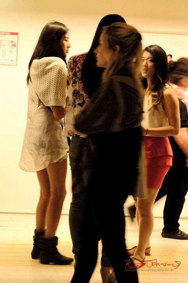 light patterned dress with short knit cardigan, black ankle boots, Serve the People art opening at White Rabbit Gallery.