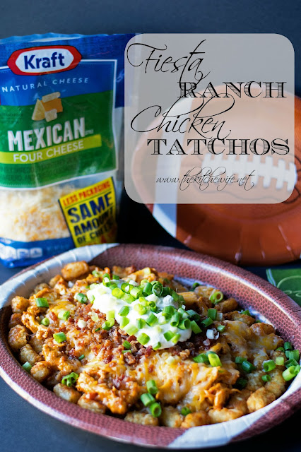 A picture of the fiesta ranch chicken tatchos prepared, on a plate, with a bad of Kraft shredded cheese in the background.