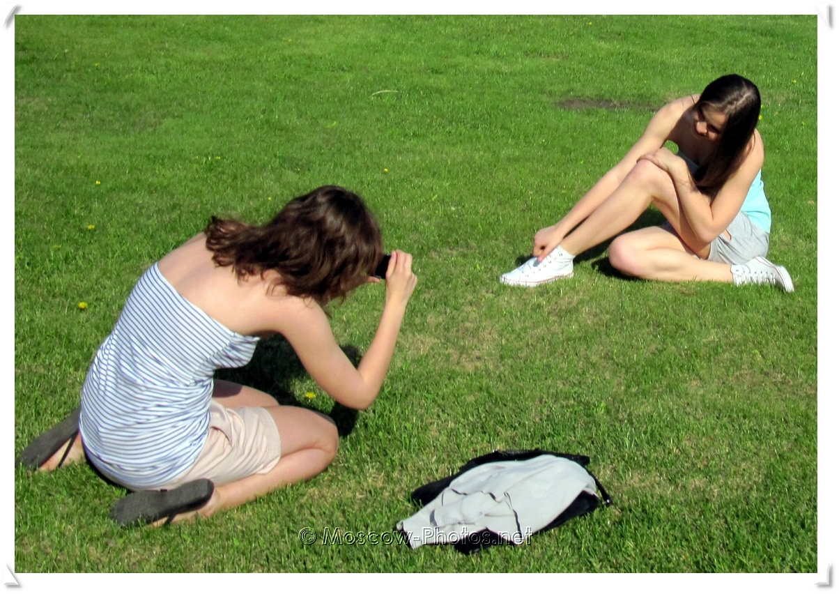 Moscow girls on the grass at summer