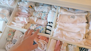 sorting baby clothing