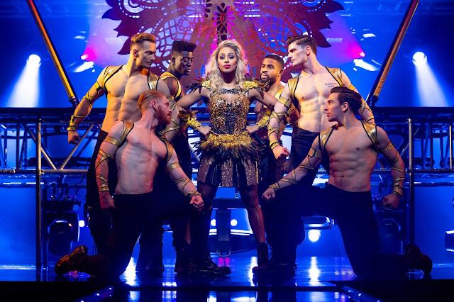 Alexandra Burke's character Rachel Marron, on stage, surrounded by dancers