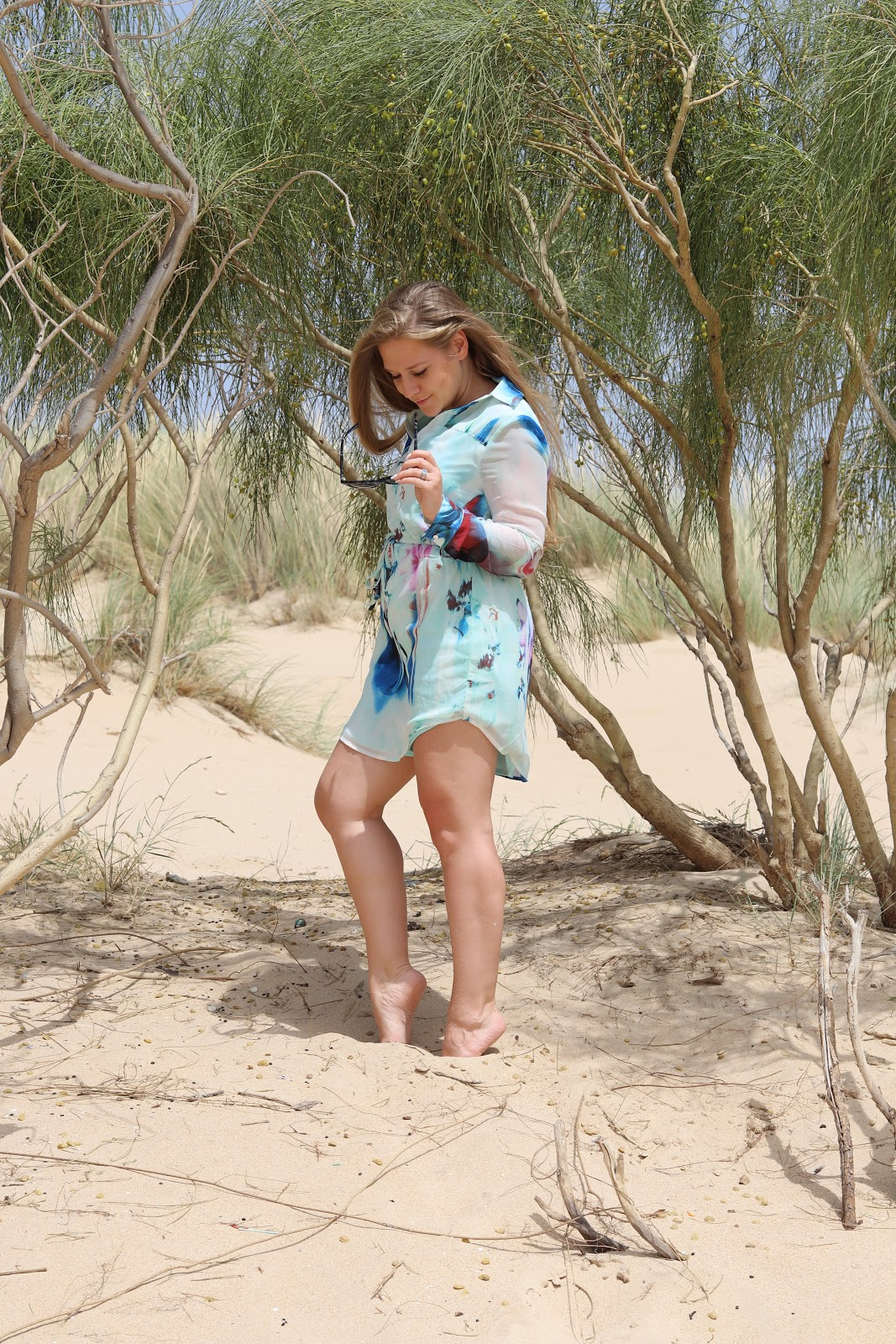 Blonde Girl on Beach wearing Blue Quiz Shirt Dress in Tarifa, Spain