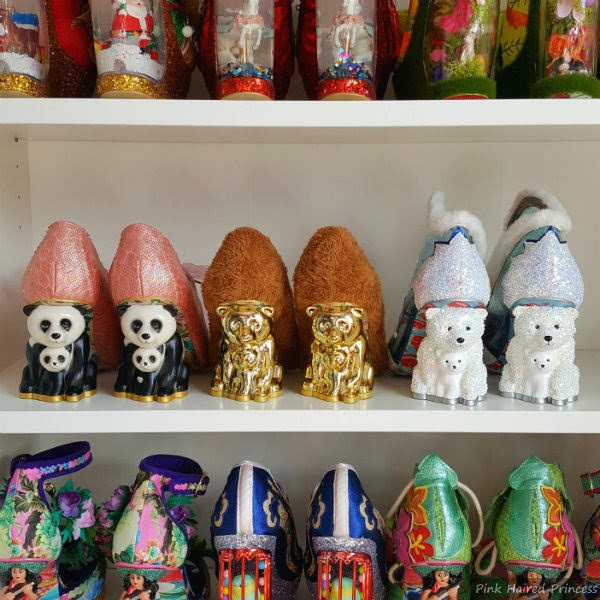 panda heeled shoes beside gold bear, next to polar bear heels on shelf