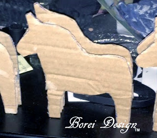 how to make a recycled paper mache book page Swedish Christmas dala horse or dalahast