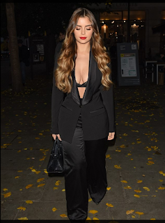 Demi Rose puts on a VERY full figured presentation as she flashes her bra in a diving dark silk suit