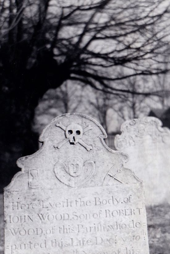 This stark head-stone with skull and cherub, hour-glass, and pick and shovel is the memorial to seventeen-year-old John Wood, who died in 1757 Image by Dorothy Colville, part of The Peter Miller Collection