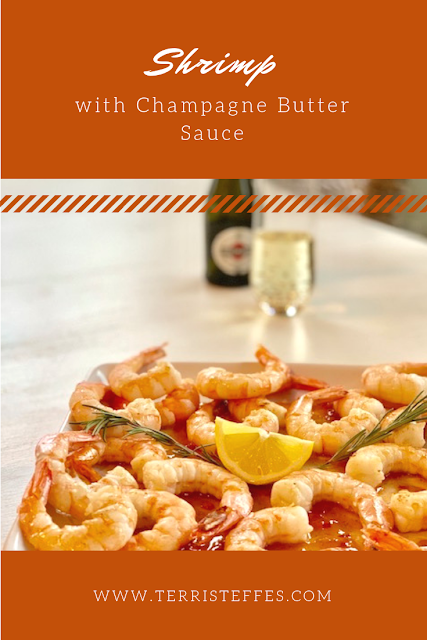 A beautiful dish of shrimp sitting on a bed of Champagne Butter Sauce.