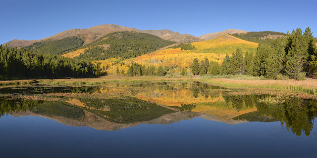 reflection of Mt. Elbert on a high pond in Autumn