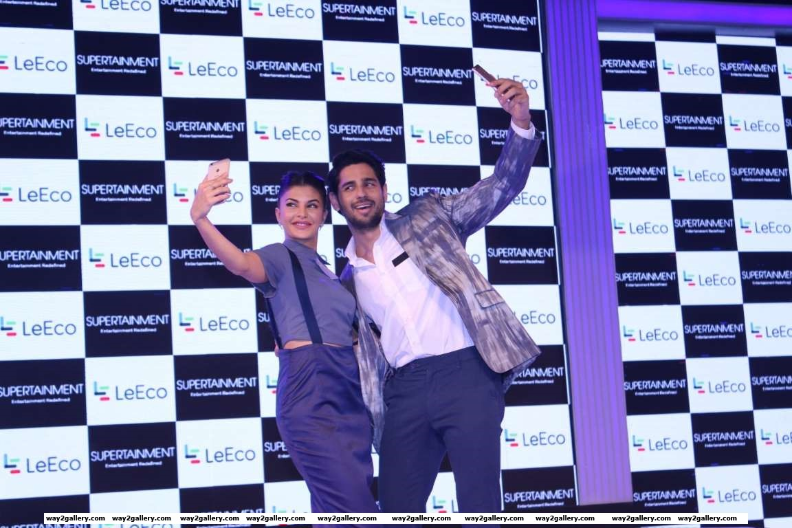 Jacqueline Fernandez and Sidharth Malhotra pose for a selfie during the launch of the new smartphone LeEco in Mumbai