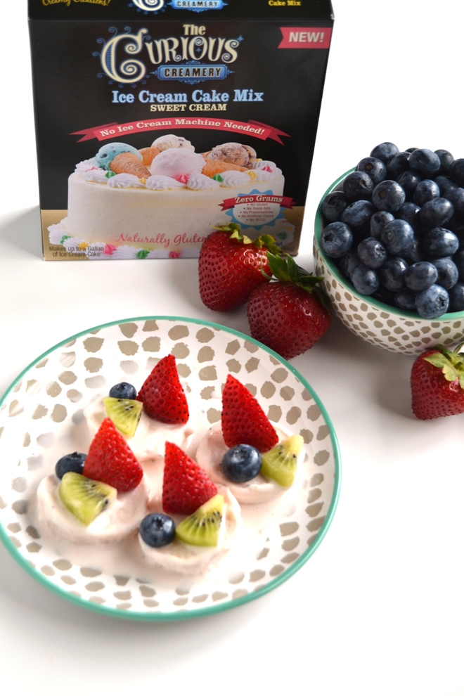 Make your own ice cream cake at home with this easy, homemade strawberry sweet cream ice cream topped with fresh fruit for the perfect celebration! www.nutritionistreviews.com