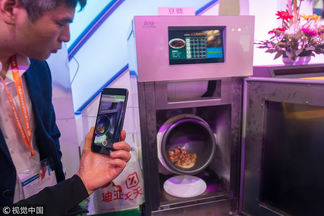 Chinese man invents smart robot cooker because of his wife's inability to cook