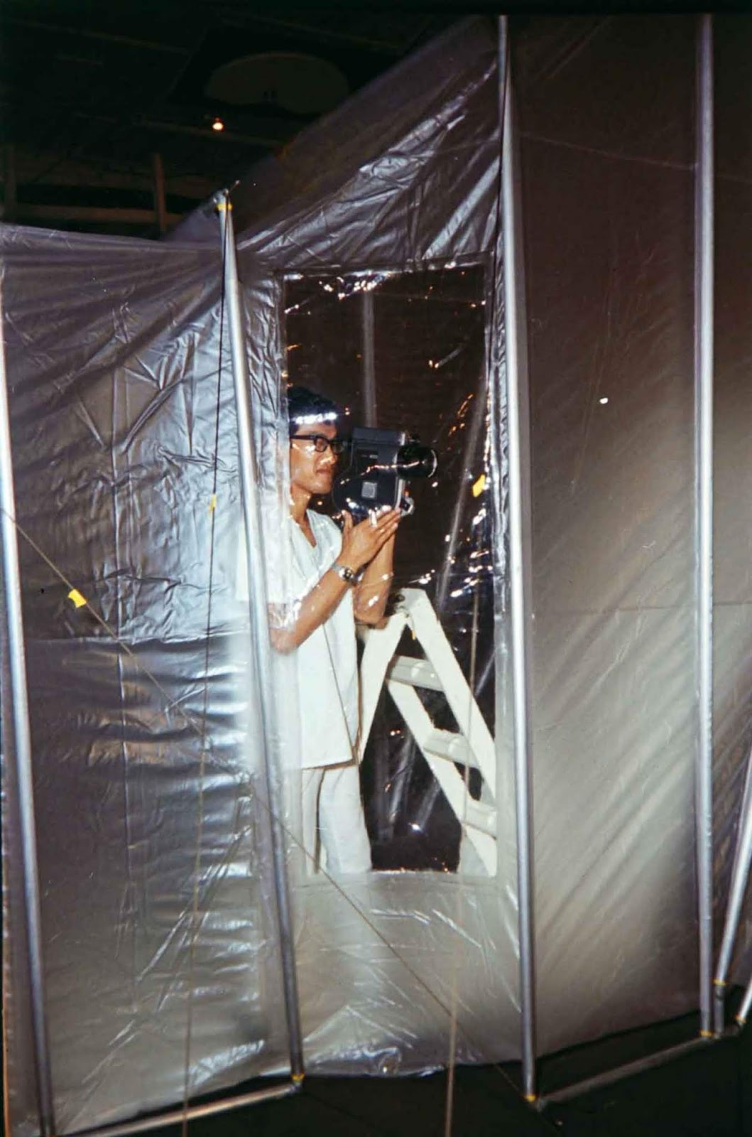 Man taking video with video recorder camera at mobile quarantine facility for Apollo 11 Moon Flight, 1969.