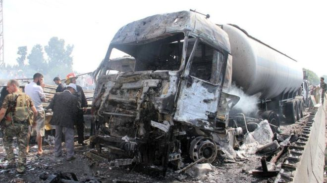 Syria conflict: IS claims wave of bombings that kills dozens