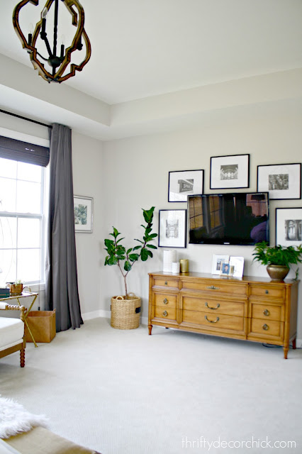 Gallery wall of frames around TV