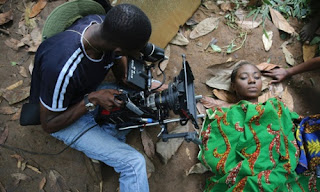 A cameraman films a scene for the Nollywood film October 1 in Nigeria.