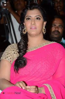 Actress Varalakshmi Pictures in Pink Saree at Madha Gaja Raja Audio Launch  0043.JPG