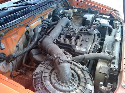 Steam washing an engine.