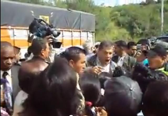 Correa discute con comerciantes