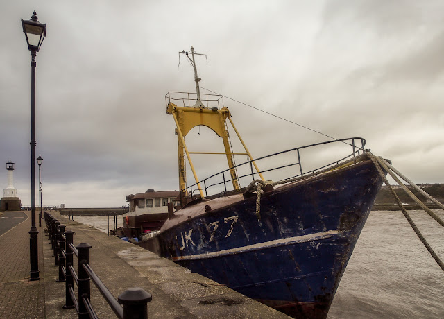 Photo of the former trawler safely tied up alongside