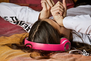 Girl lying down with headphones