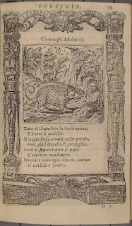 A page of italic print with an ornamental border and a woodcut of an animal resembling a rat.