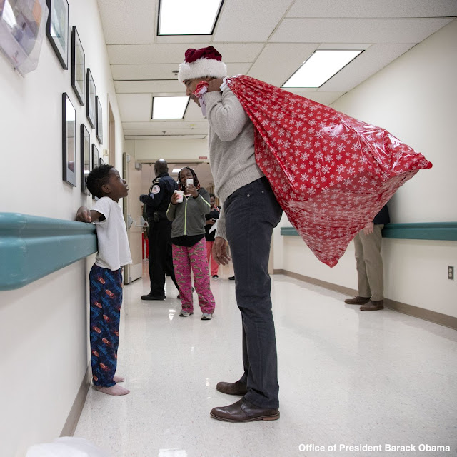 Photos: Barack Obama dresses as Santa Claus to surprise ill Children in hospital