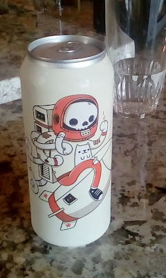 beer can with astronaut and cat artwork