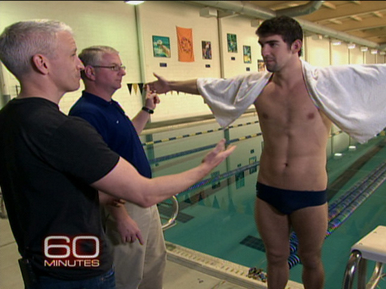 Anderson Cooper and Michael Phelps strip half-naked and compare bulges...er...I mean...have a race.