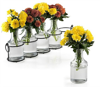Glass Bottle Vases for holding flowers on your table.
