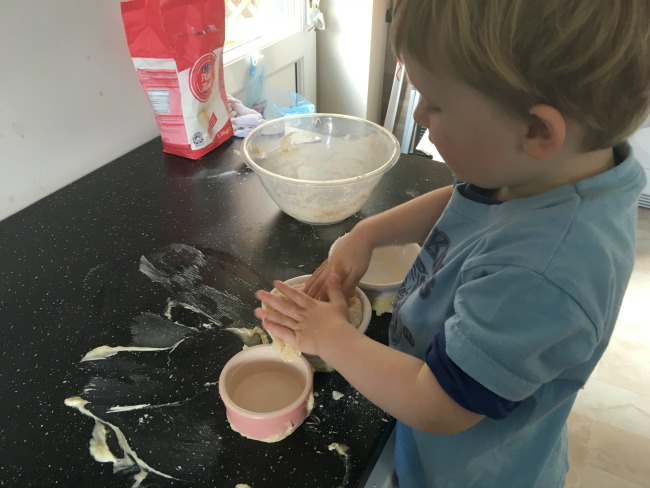 Toddler-hands-mixing-flour-and-butter
