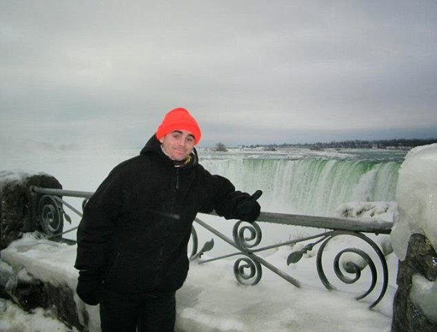 Pictured at Niagara Falls. The whole journey took him five years to complete. - A Big Thumbs Up. Traveller Hitchhikes 100,000 Miles Around The World Without Spending Any Money