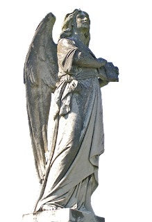 A large concrete angel statue with spread wings, holding a book as he/she looks up towards heaven.