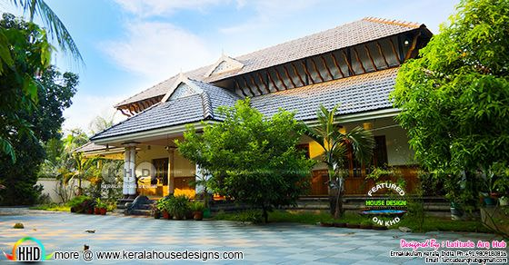5 bedroom sloping roof traditional Nalukettu Kerala home